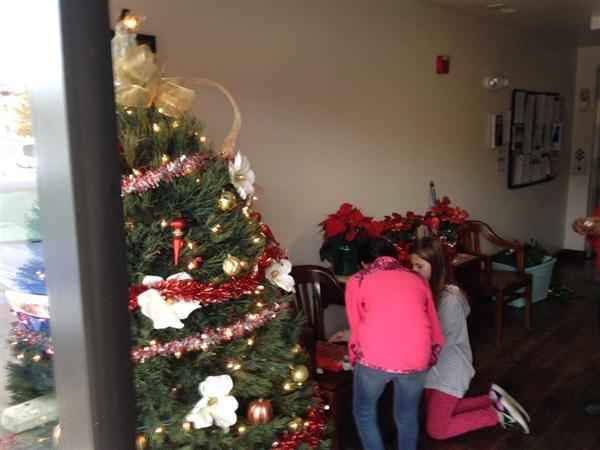 Student Decorating for Holiday Celebration